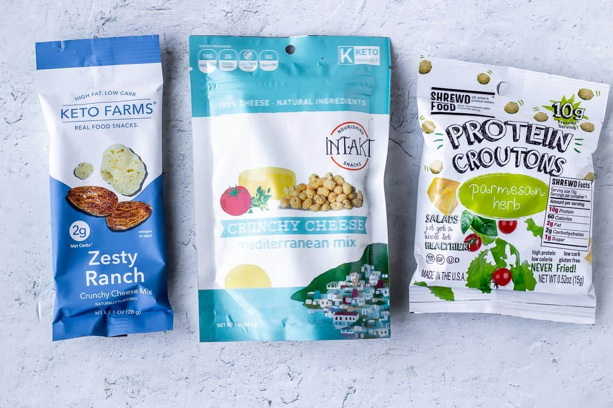 keto farms crunchy cheese mix, intakt foods crunchy cheese, and shrewd foods protein croutons on a white background