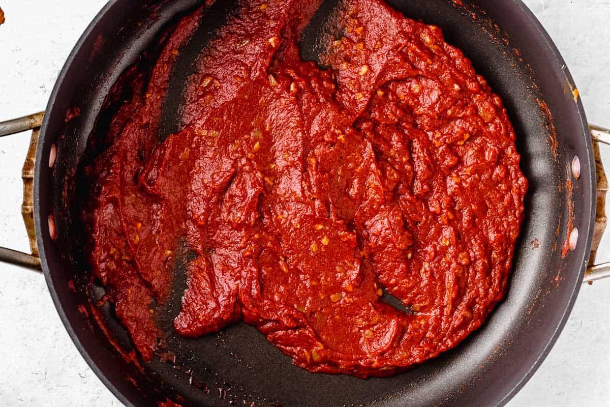 Tomato puree in a black skillet