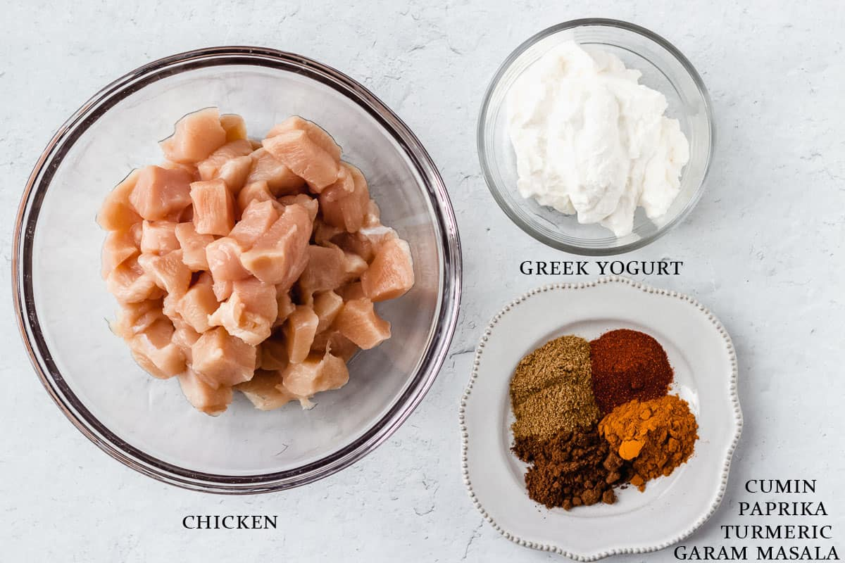 Butter chicken marinade ingredients on a white background with labels