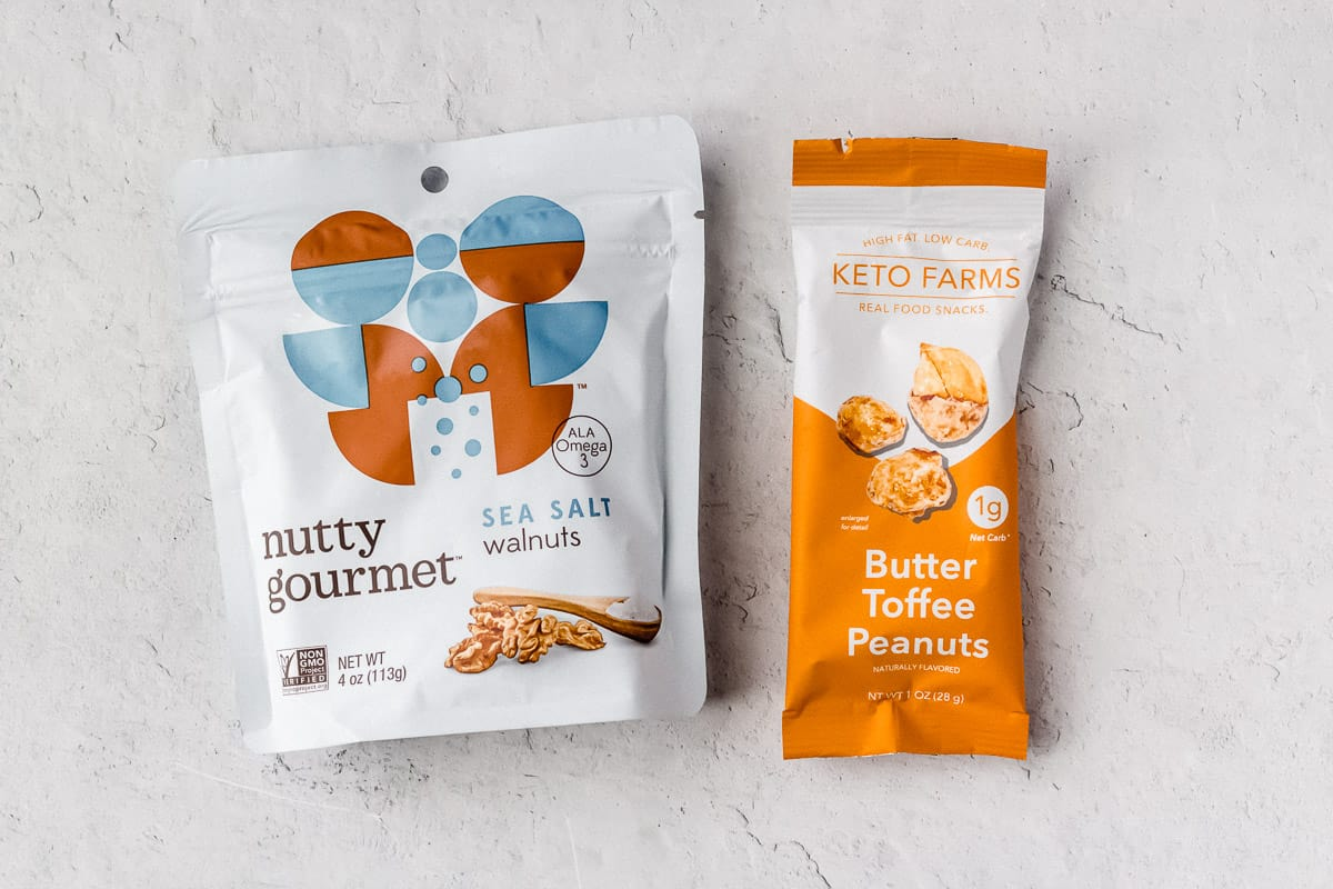 A package of walnuts and keto butter toffee peanuts on a white background
