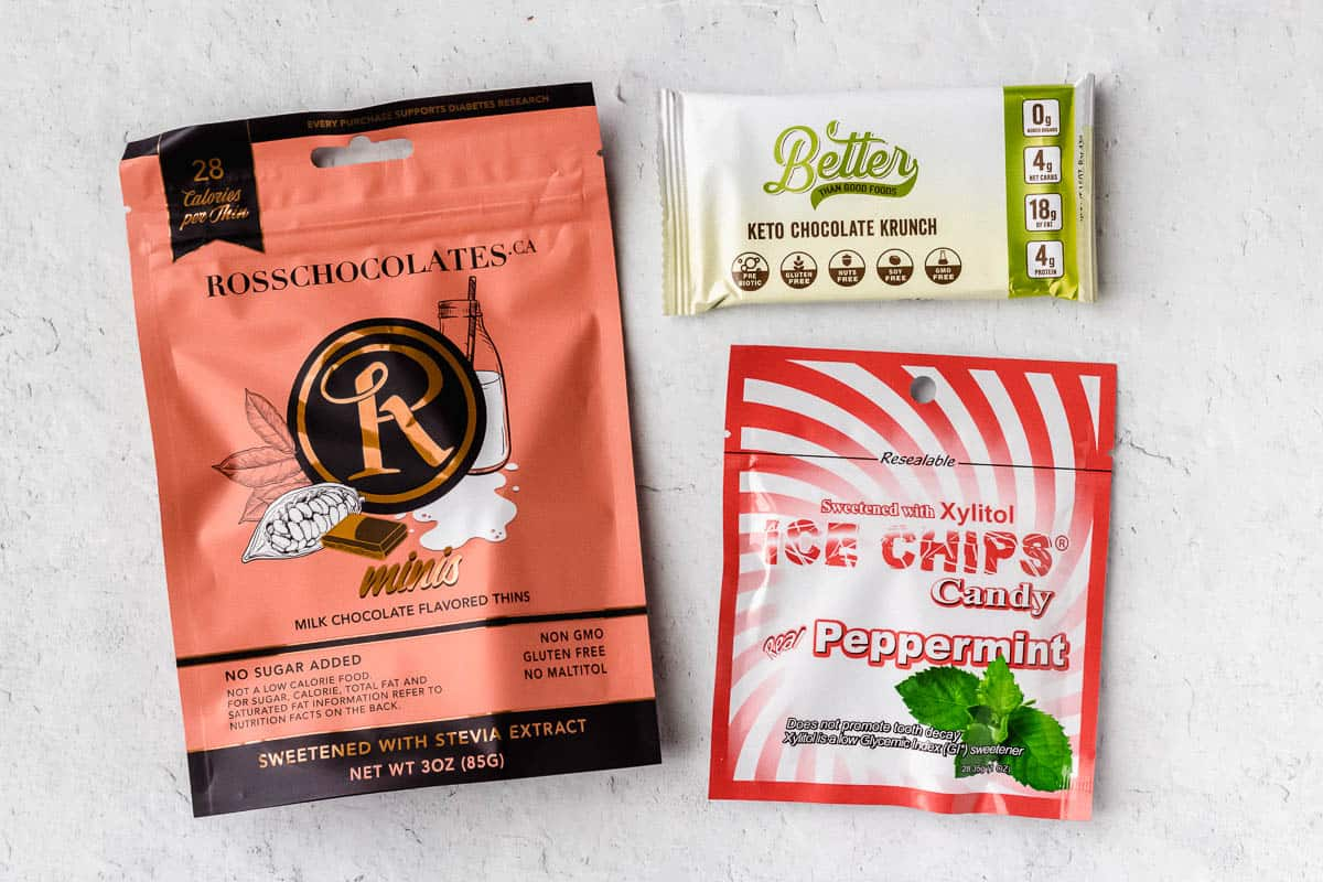 3 different keto candy packages on a white background