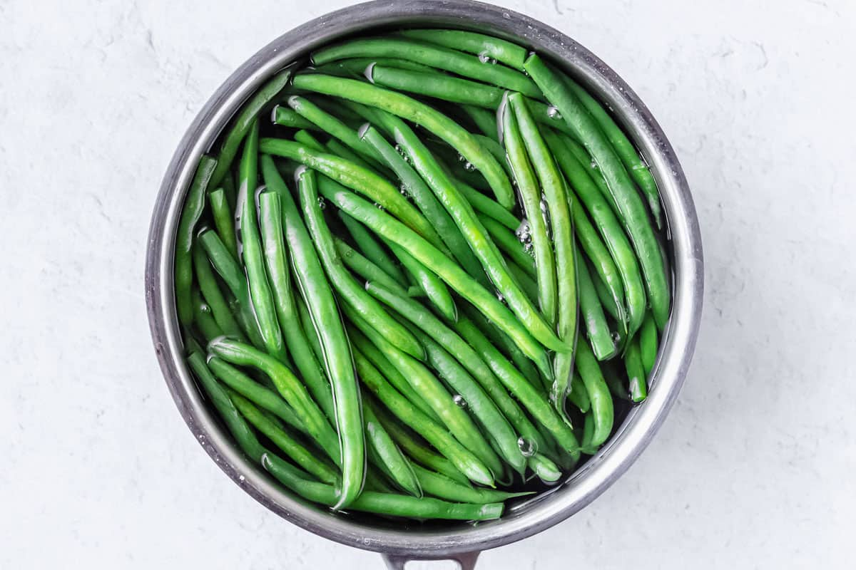 Green Beans in a pot over a white background