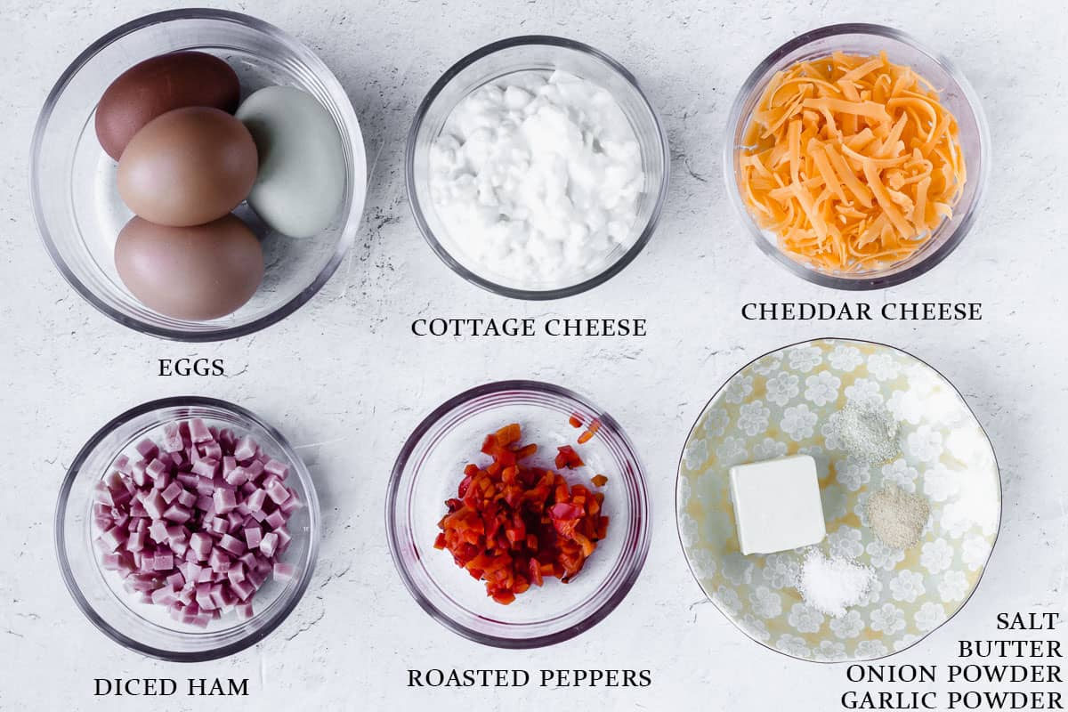 Ingredients needed to make instant pot egg bites with labels on a white background