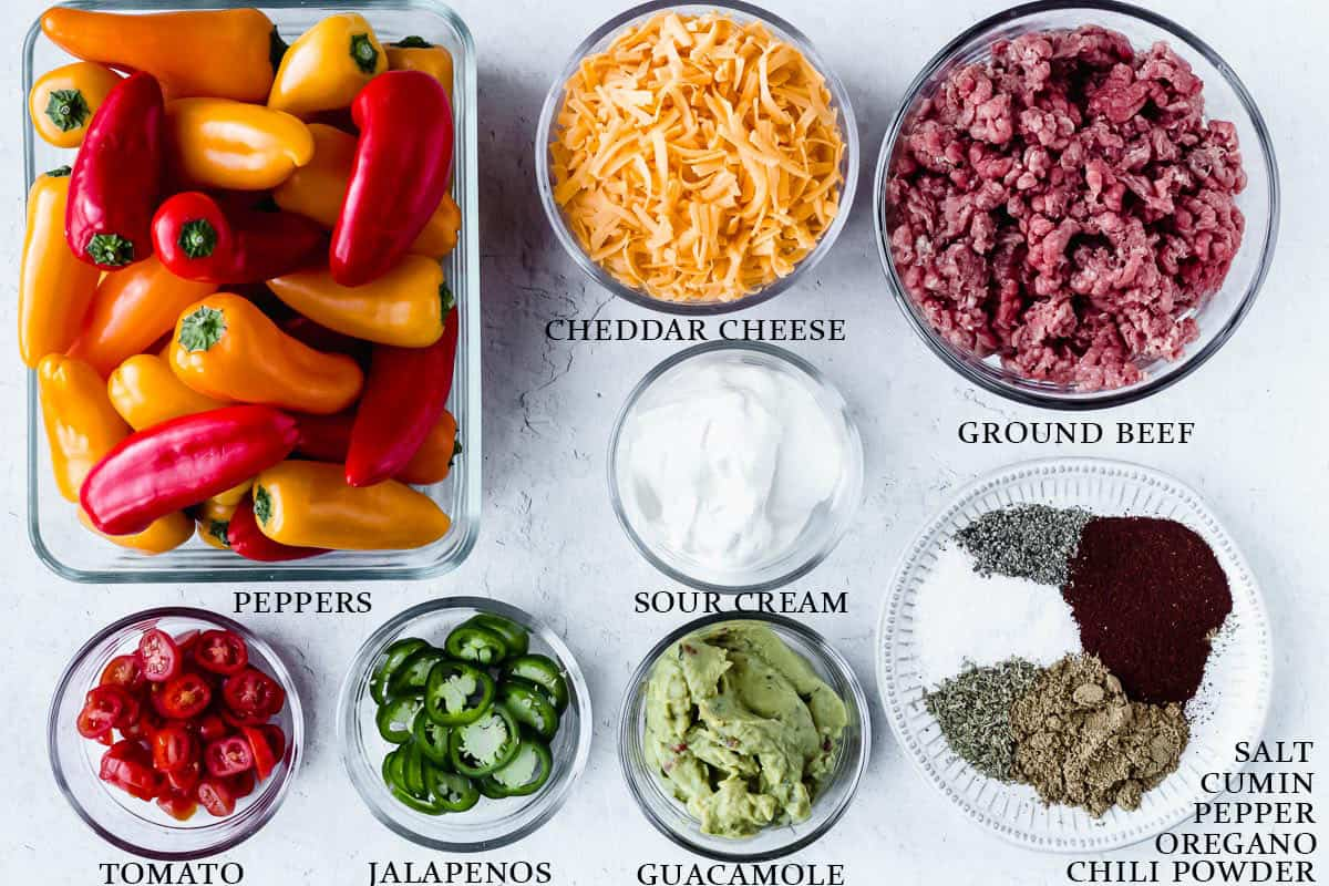 Ingredients to make loaded bell pepper nachos on a white background with labels