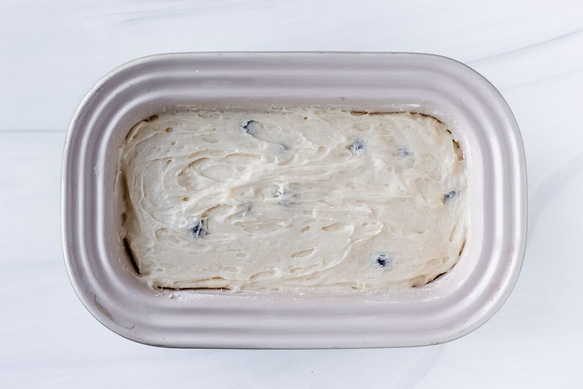Blueberry pound cake batter in a loaf pan prior to baking