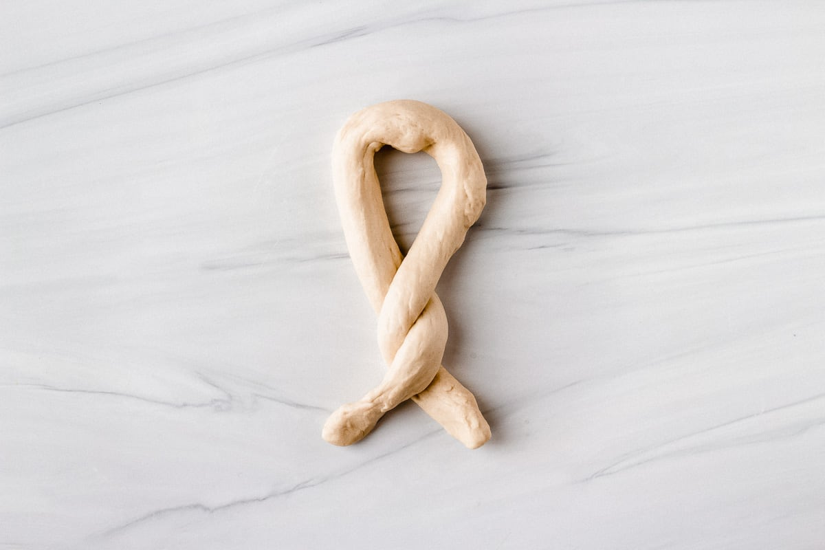 Pretzel dough rolled into a rope with ends twisted together twice