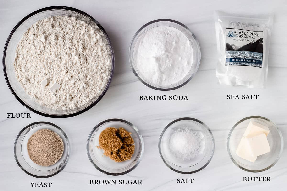 Ingredients to make homemade soft pretzels on a white background with labels