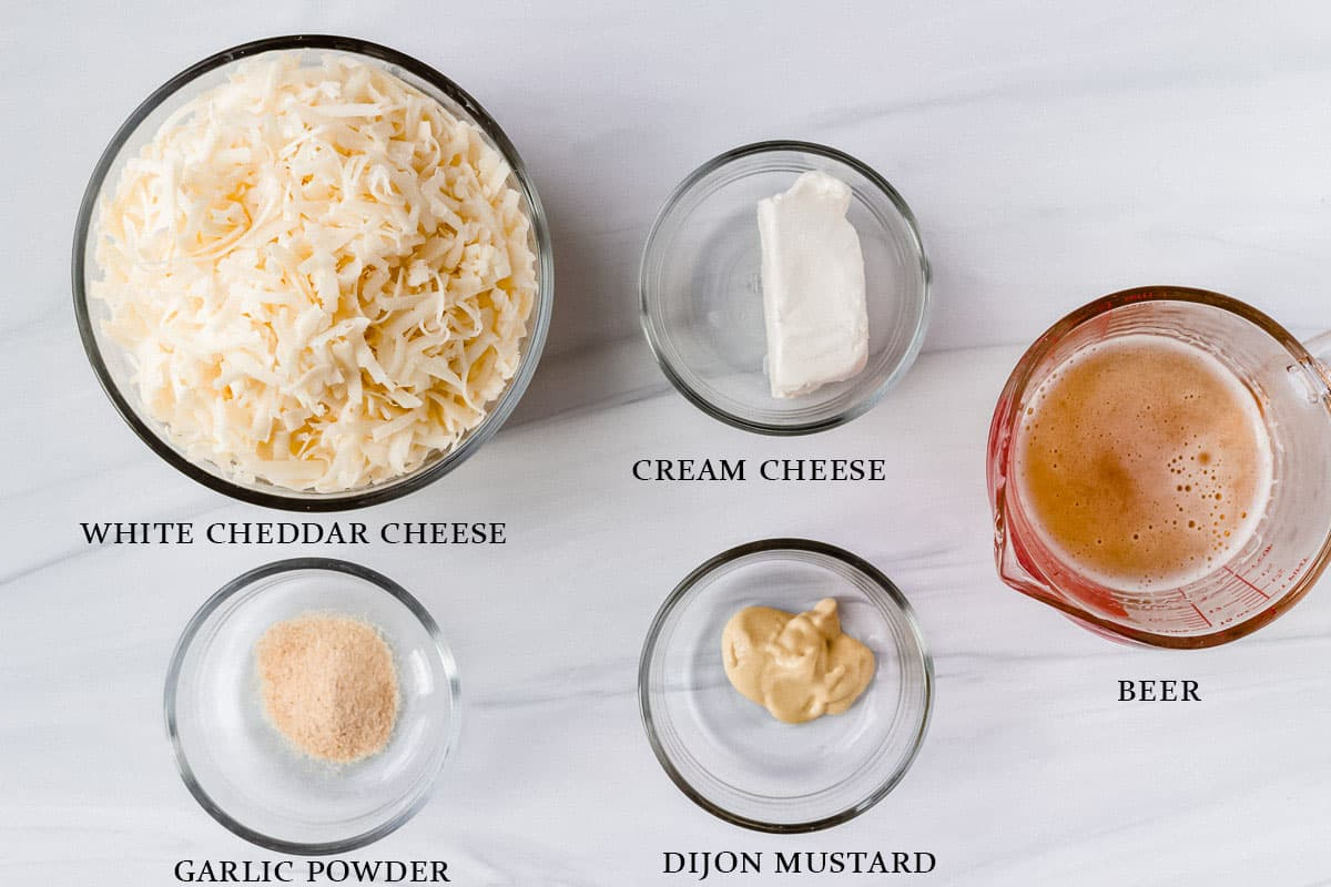 Ingredients needed to make beer cheese dip labeled on a white background