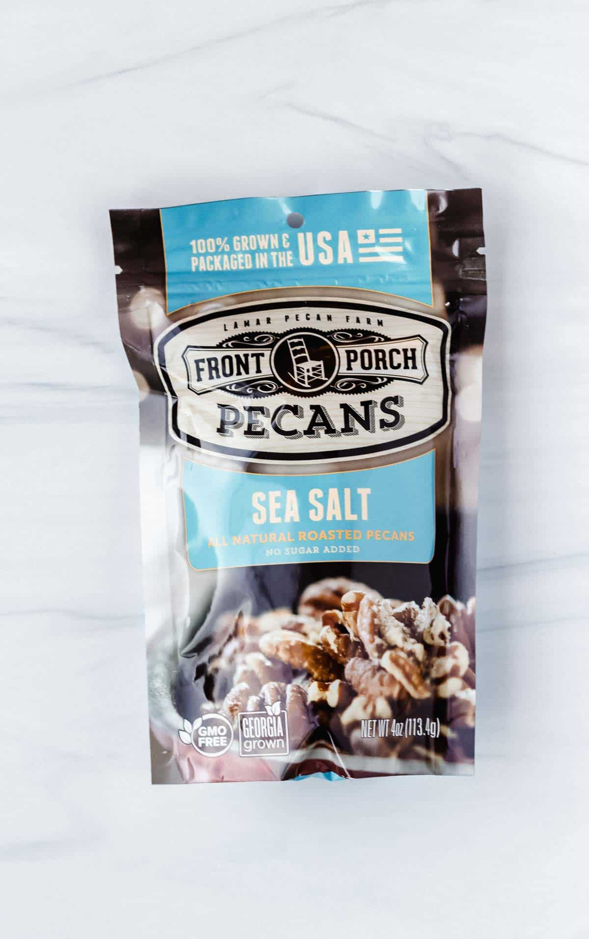Bag of front porch pecans on a white background