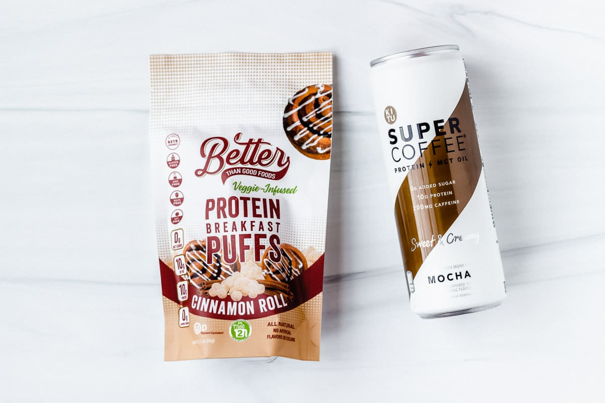Keto cereal bag and super coffee can on a white background