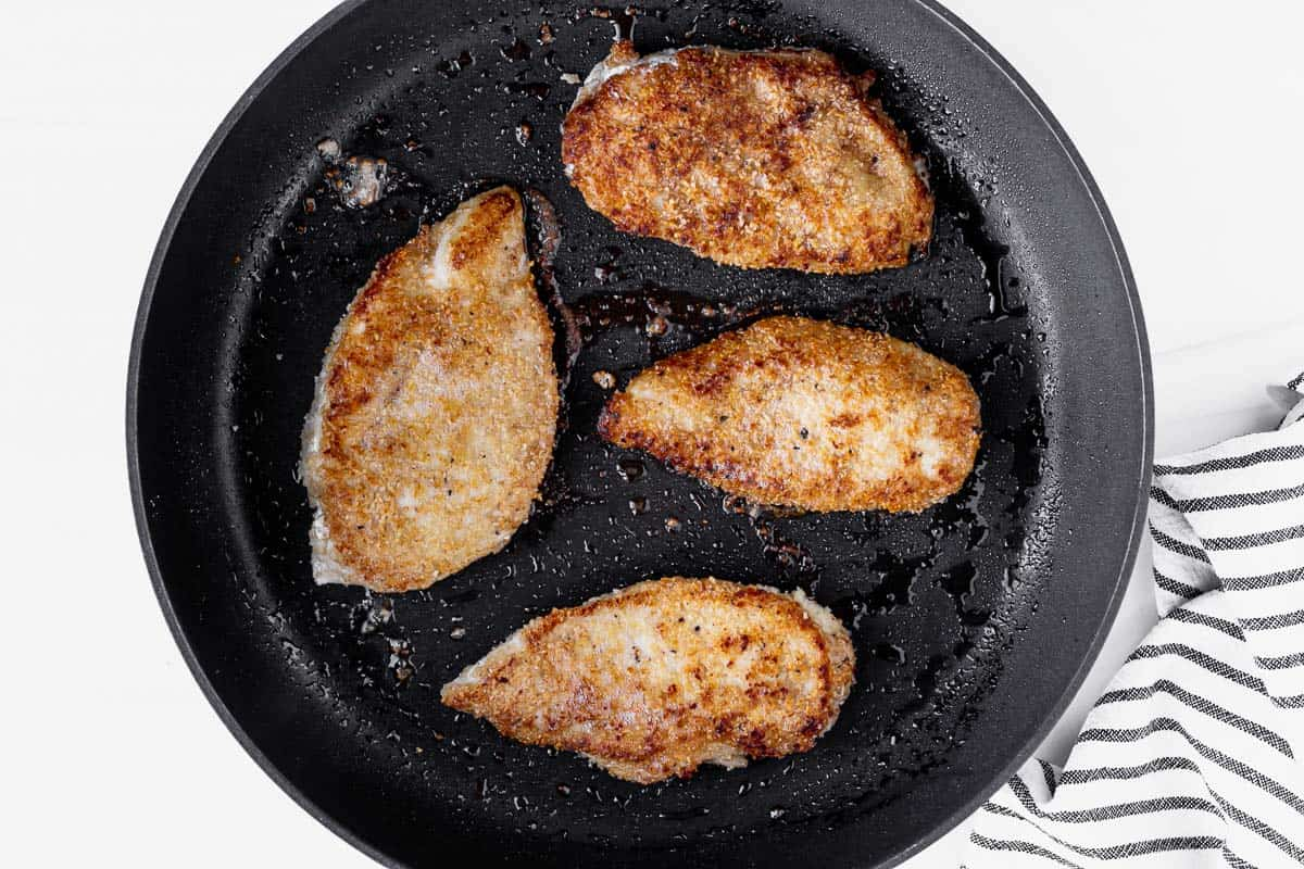 Browned chicken breasts in a skillet