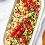 Keto zucchini pasta salad with text overlay