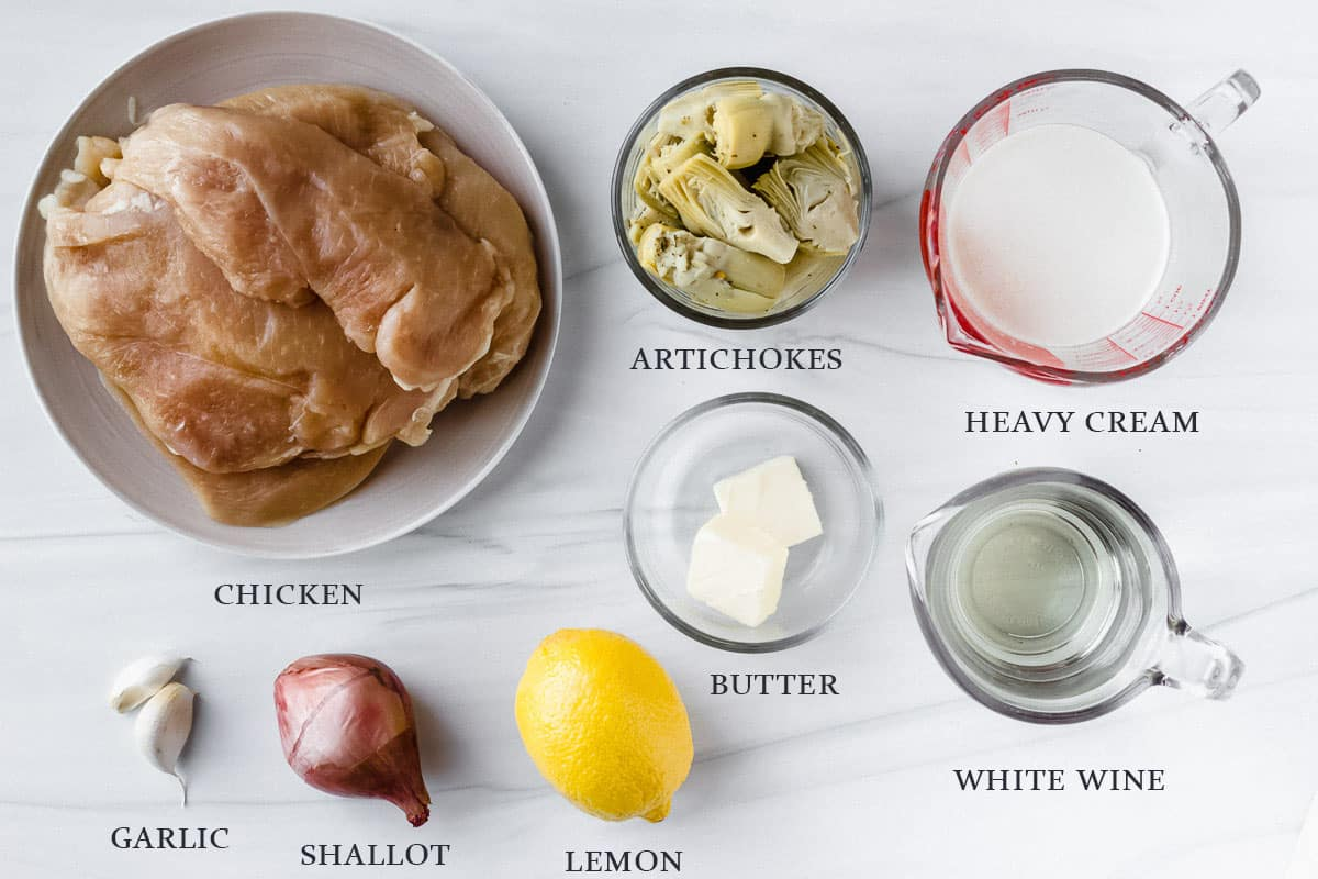 Ingredients needed to make lemon artichoke chicken on a white background with labels