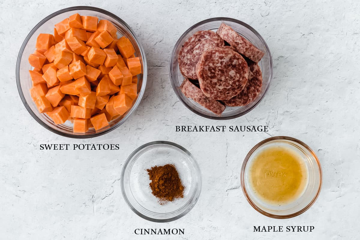 Ingredients to make maple sausage sweet potato hash on a white background with labels