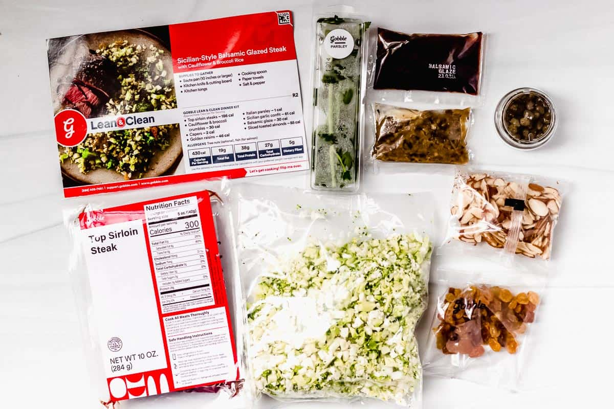 Ingredients to make sicillian steak and vegetables laid out on a white backdrop