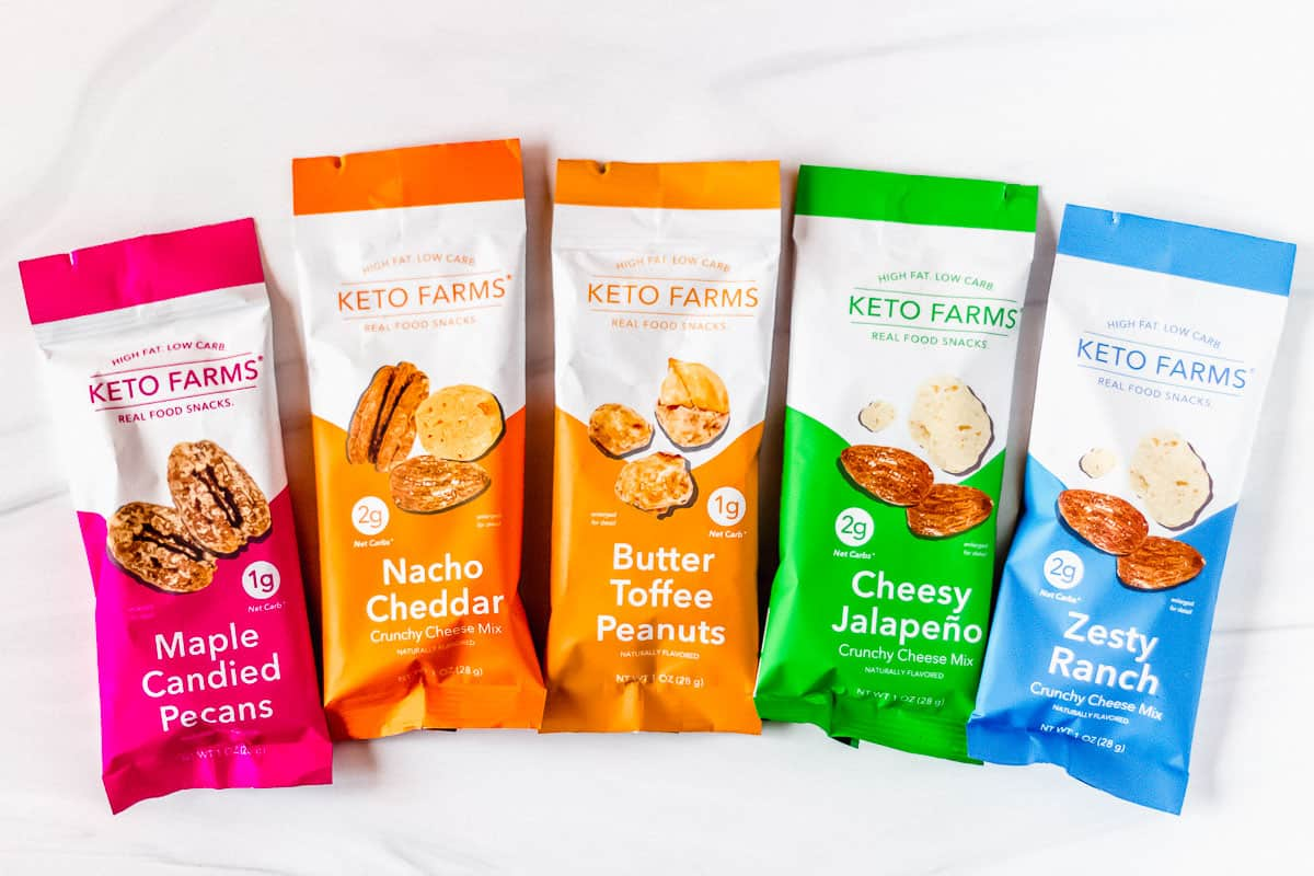 5 packages of Keto Farms snacks on a white background
