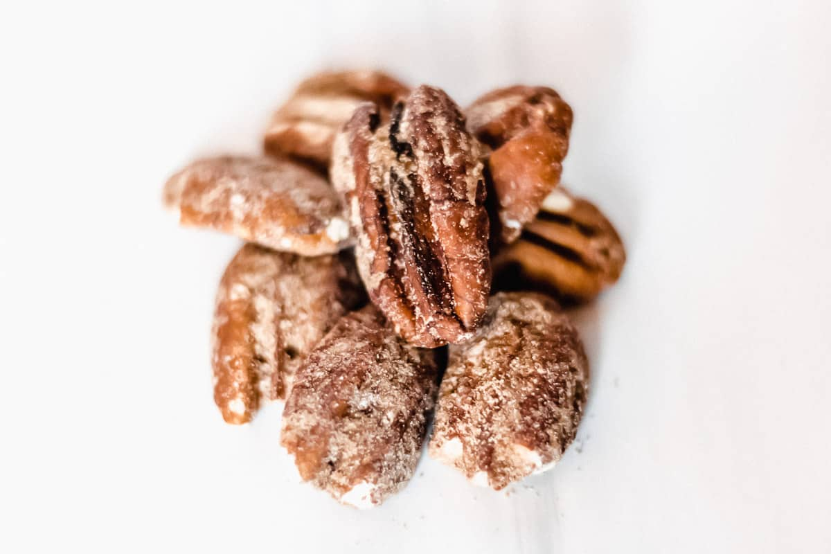 Keto Farms Maple Candied Pecan in a pile on a white background