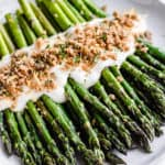 Broiled asparagus with cheese sauce with text overlay