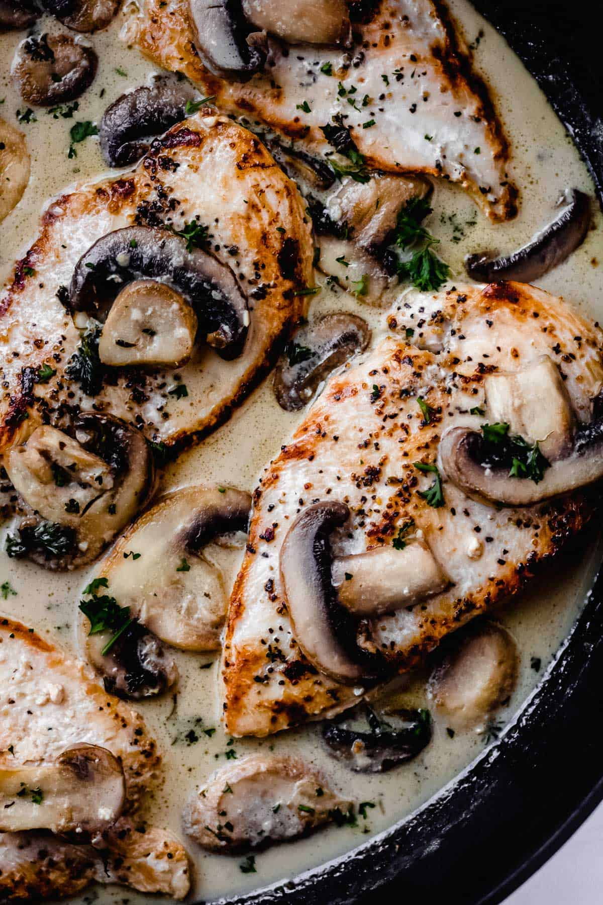 Overhead close up of Chicken Diane in a black skillet
