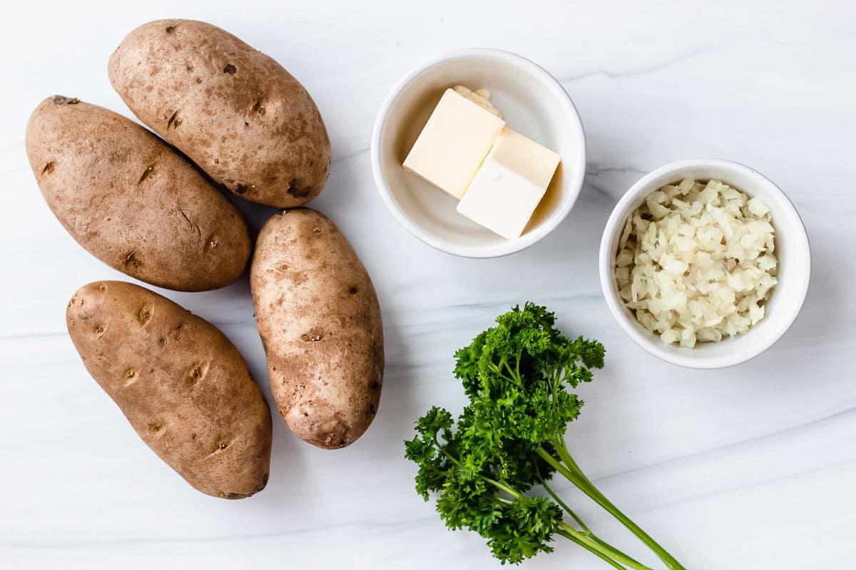 Ingredients to make lyonnaise potatoes on a white background