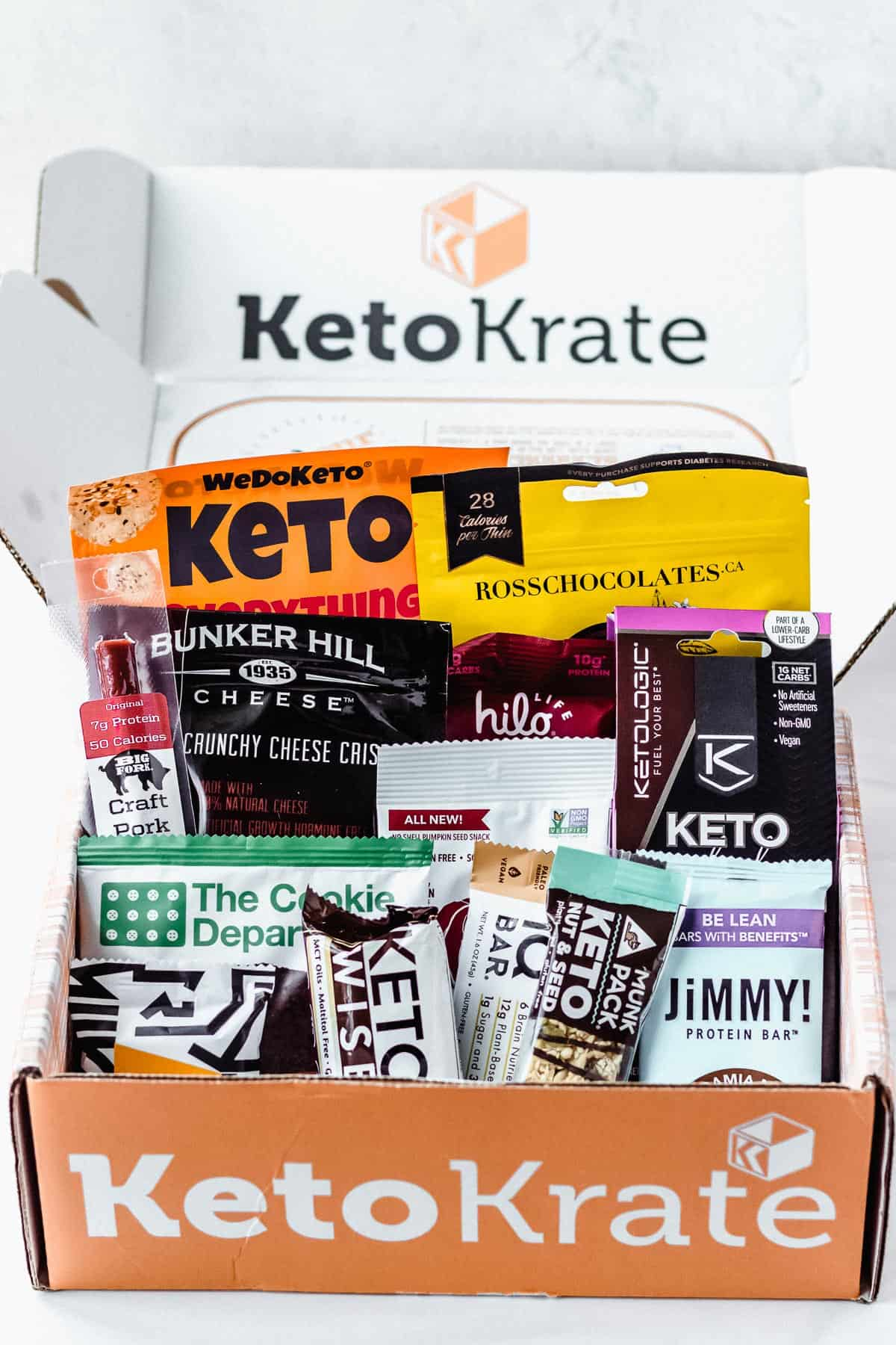 March 2021 Keto Krate box with all of the snacks included displayed inside