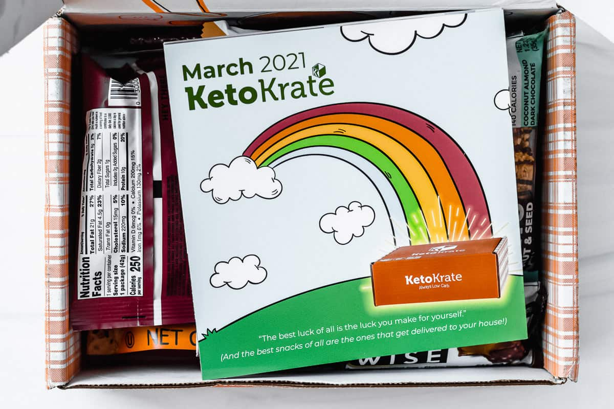 Opened march 2021 keto krate with the insert pamphlet on top of the snacks