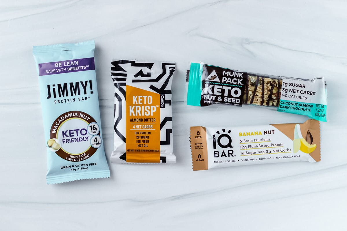 4 different keto bars on a white background
