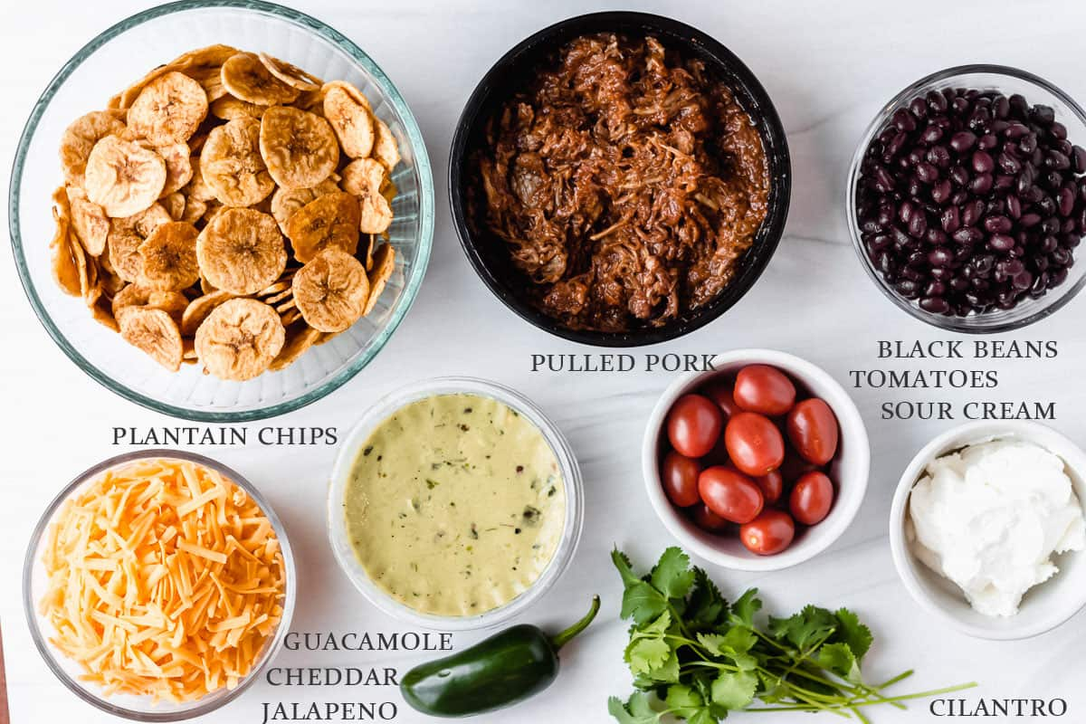 Ingredients needed to make pulled pork nachos on a white background with labels