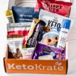 The april 2021 keto krate with all of the keto snacks displayed inside of the box