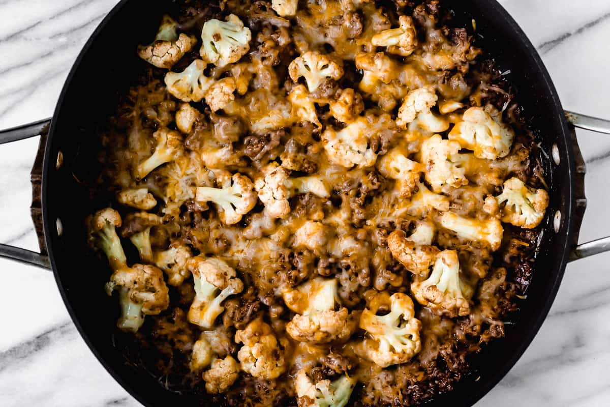 Baked barbecue ground beef and cauliflower skillet in a black pan