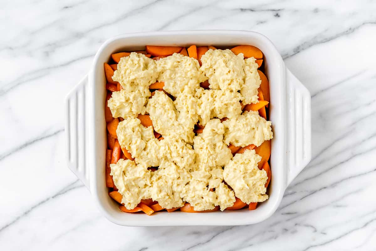 Apricot cobbler in a square, white baking dish prior to baking
