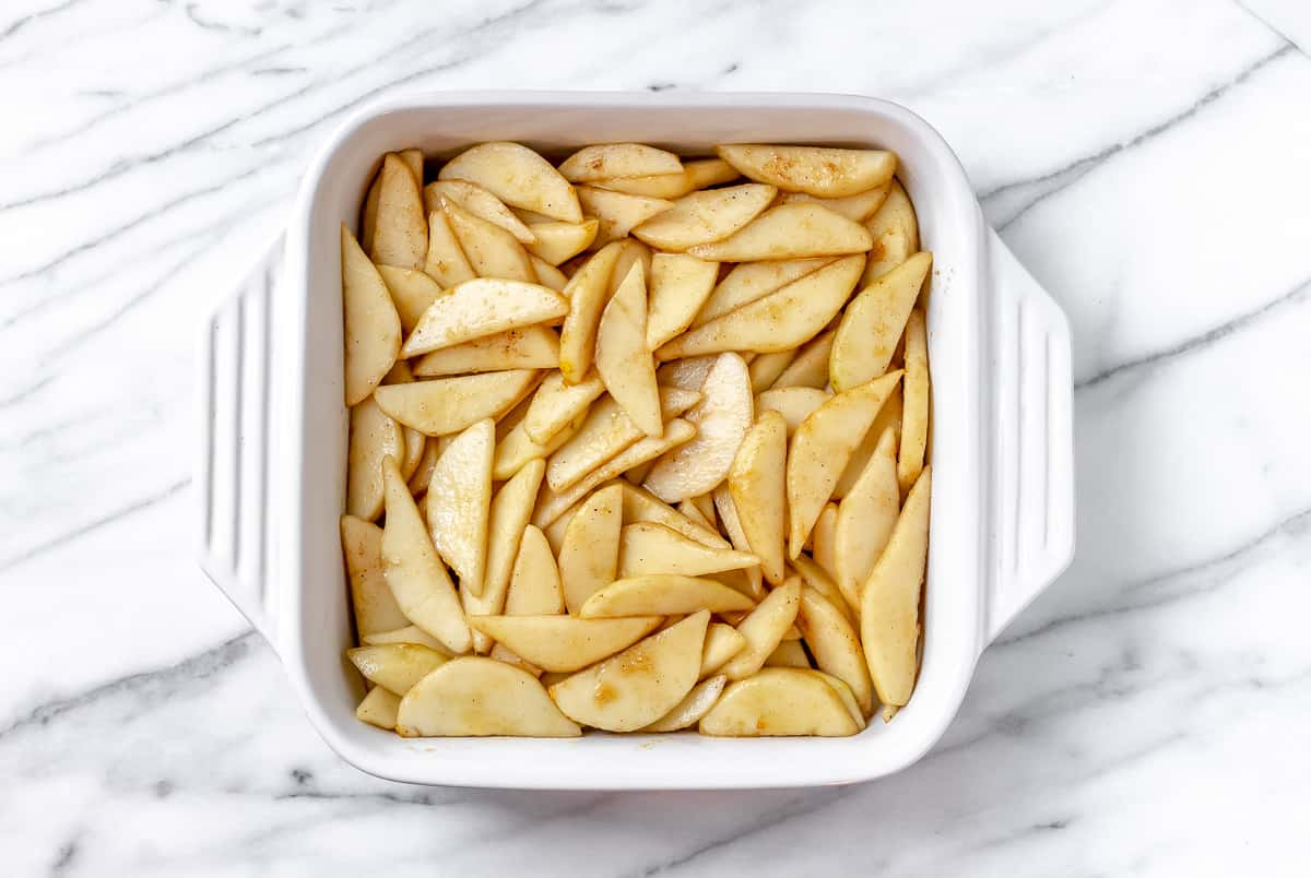 Pears in a white square baking dish