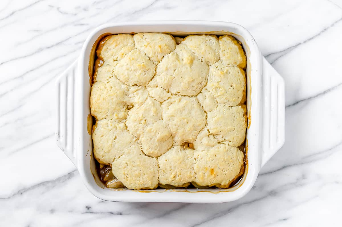 Baked pear cobbler in a white, square baking dish