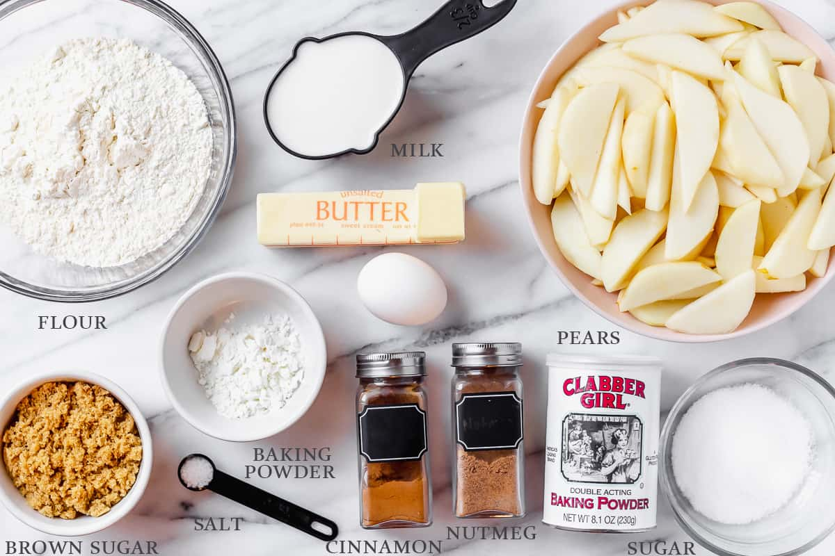 Ingredients for pear cobbler on a white background with labels
