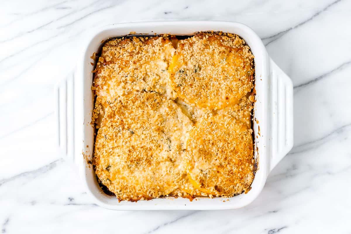 Baked Rutabaga Gratin in a white, square baking dish