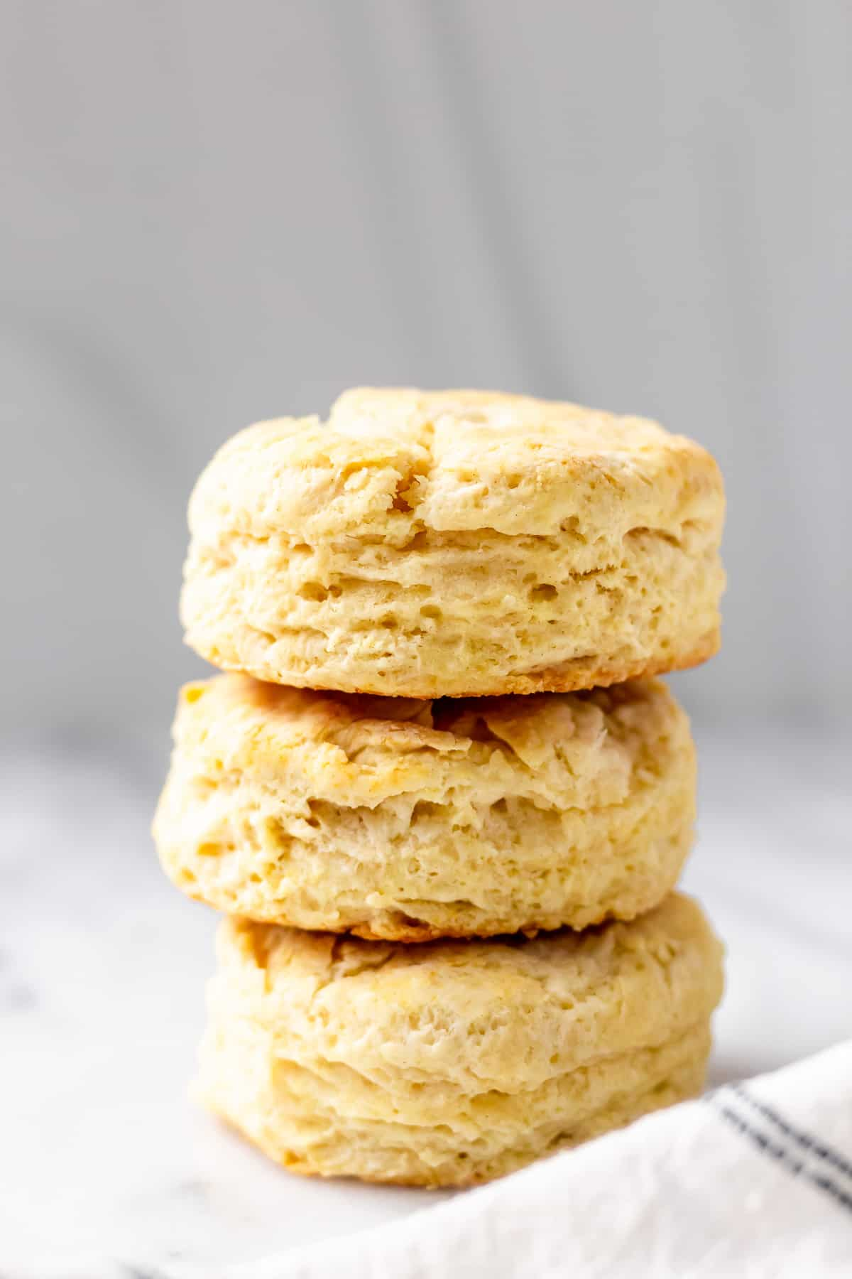 a stack of 3 country biscuits on a gray background