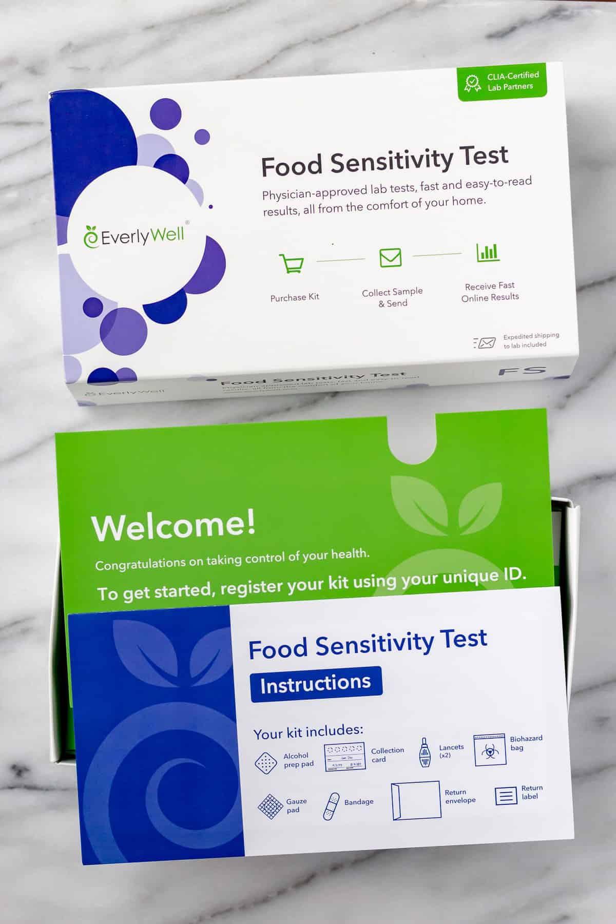 Everlywell food sensitivity test kit opened with insert cards on top