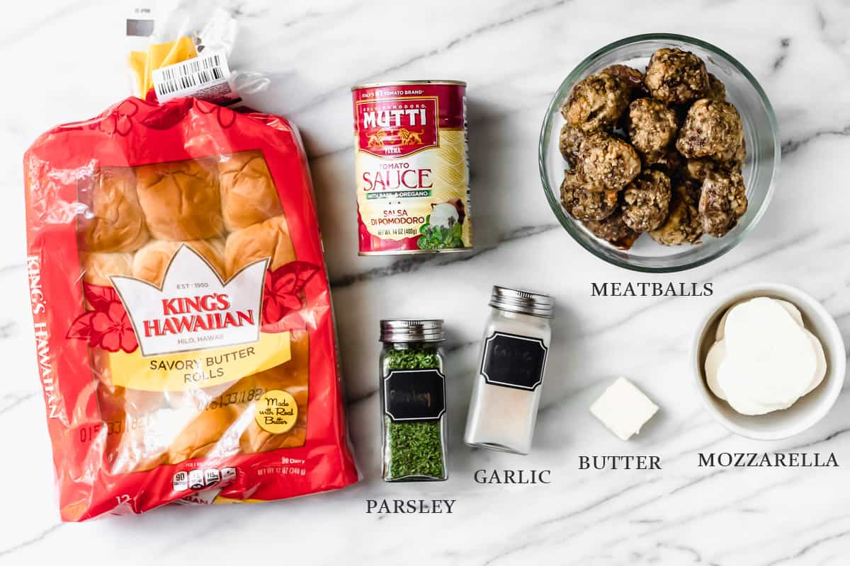 Ingredients needed to. make meatball sliders on a marble background with labels
