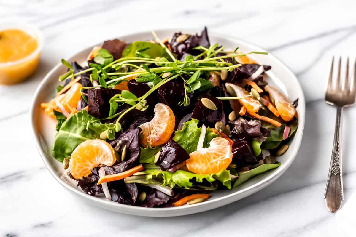 Sprinly Citrus Detox Salad with Beets and Fresh Oranges prepared and plated on a white plate