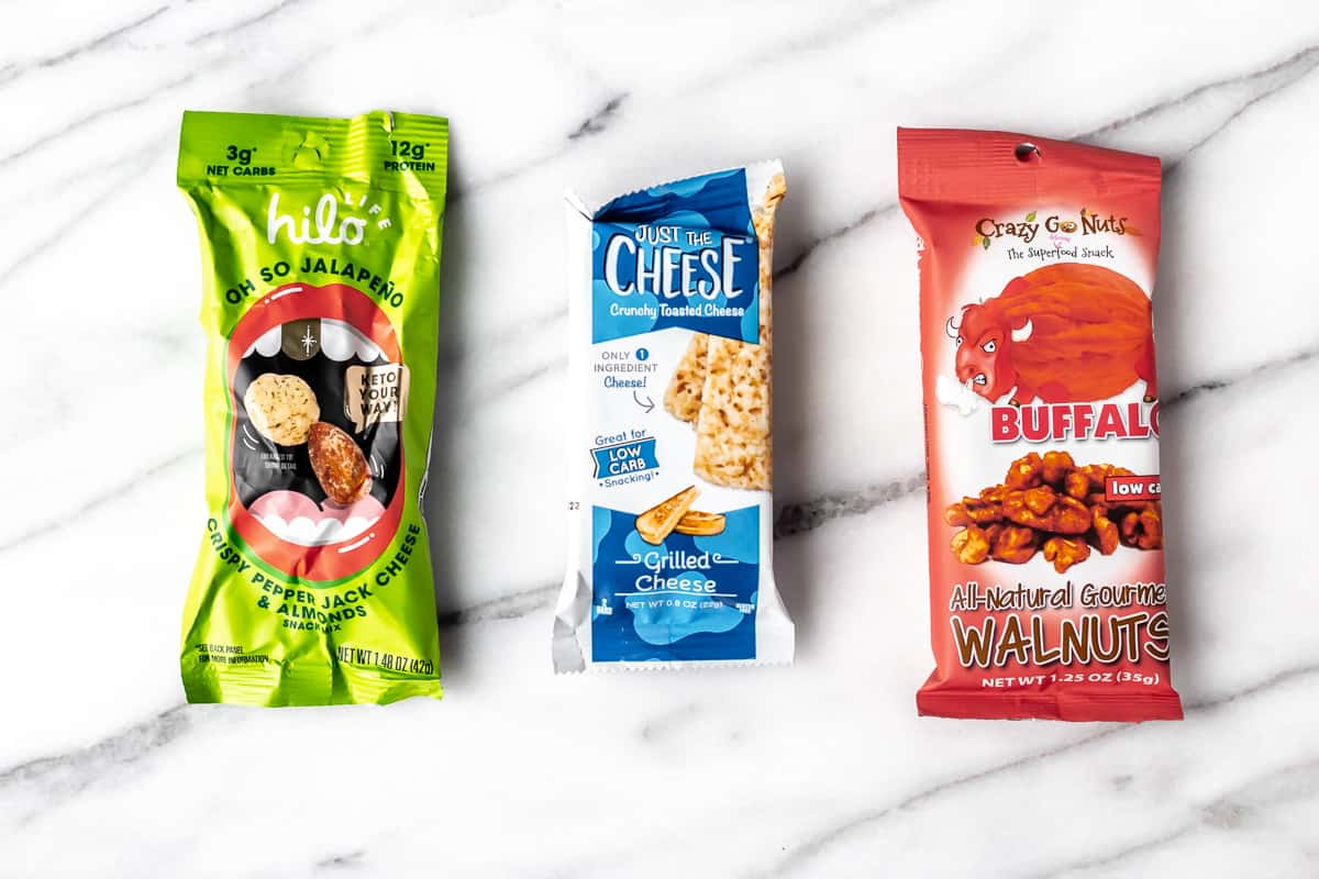 3 pack of keto nuts and cheese snacks on a marble background