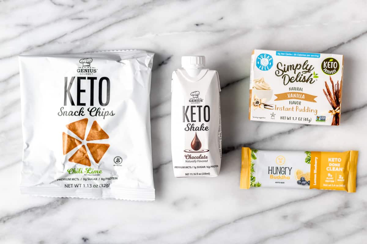 4 keto snacks on a marble background