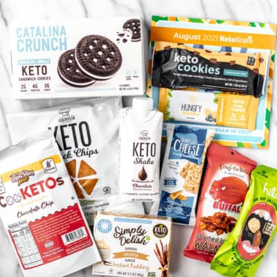 All of the items in the August 2021 Keto Krate laid out on a marble background