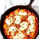 Cheesy baked ravioli casserole with text overlay