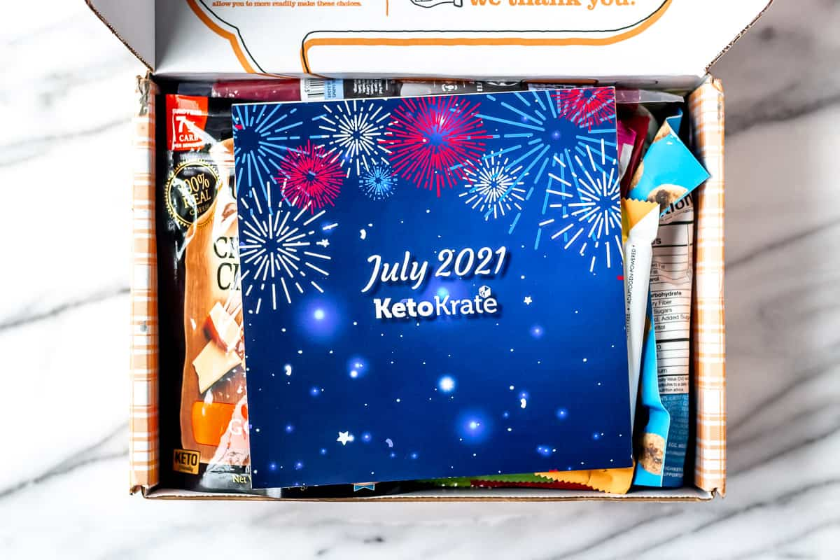July 2021 keto krate insert card on top of the snacks in the box