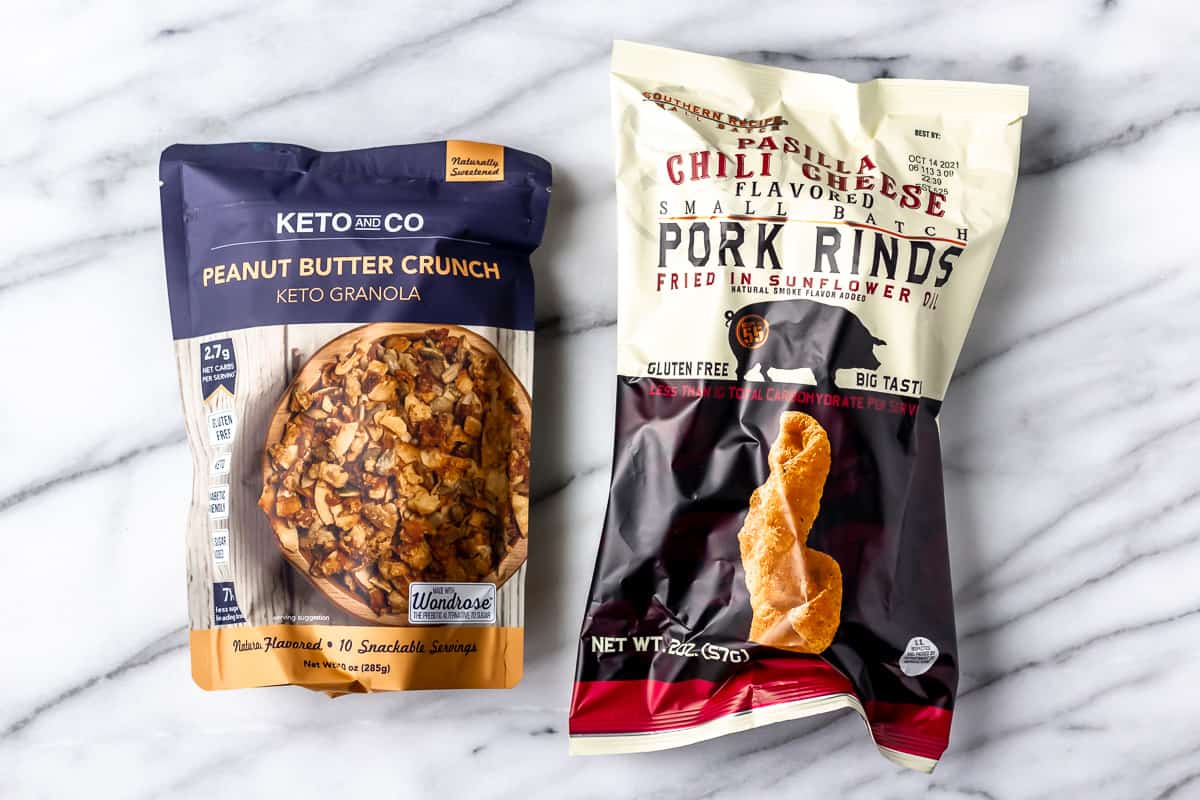 Keto granola and pork rinds on a marble background