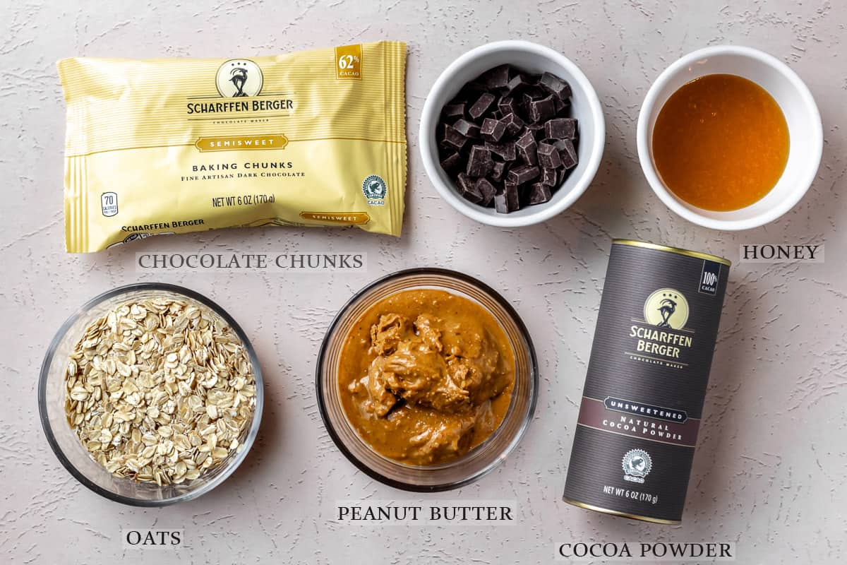 Ingredients needed to make peanut butter energy bites with chocolate chunks laid out on a light background with text overlay