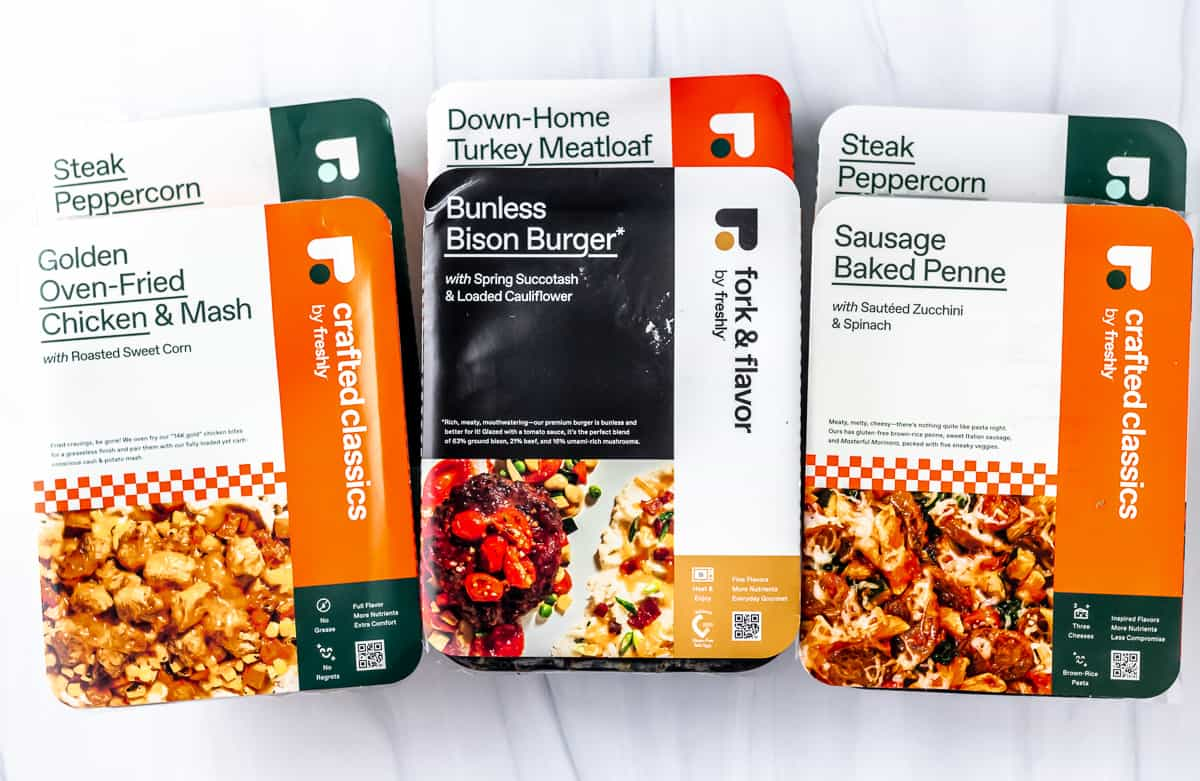 6 freshly meals in packaging stacked on top of each other