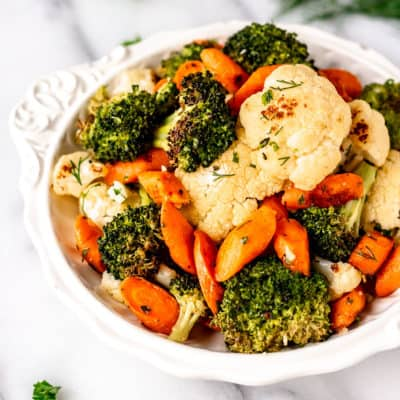 Close up of garlic herb California blend vegetables in a white bowl.