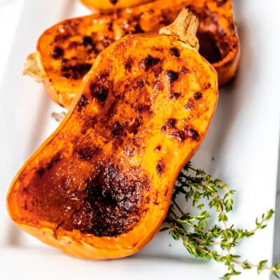 Close up of roasted honeynut squash with thyme.